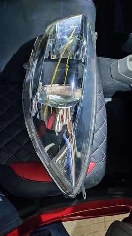 Tiago left headlight for sale
