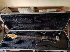 Stratocaster electric guitar with hard case