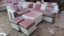 16499 corner sofa + center table + puffies at Satya furniture