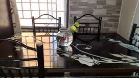 Dinning table.steel with tempered glass top.