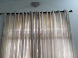 Off white net curtain with lining.