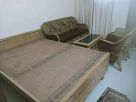 """Cane Sofa with teak wood center table and a queen size bed (5'x6'6"""")"""