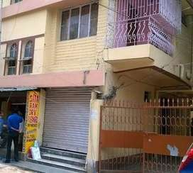Flat in commercial business market,can be used for living and godown