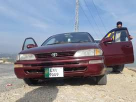 XE COROLLA 2000 MODEL COLOUR RED INTERIOR 100/100 outer showered