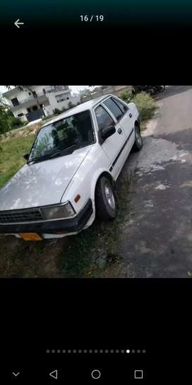 Nissan sunny white color total geniune