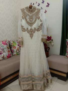 Delightful full cream coloured anarkali suit