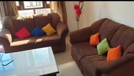 Seven seater sofa with center table