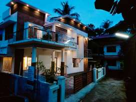 AN AMAZING NEW 4BED ROOM 2130SQ FT 5CENTS HOUSE IN MANNUTHY,THRISSUR