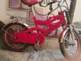 Bicycle for girls and boys in red color