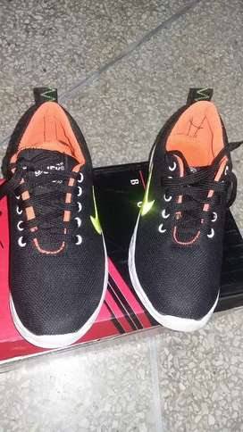 2 Pairs of sports shoes (just 2 days used)