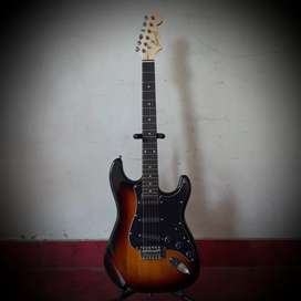 Brand new electric guitar with tremolo, and key.