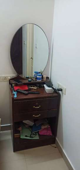 Dressing table with oval shape mirror and writing pad