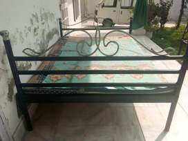 Rot iron double bed.