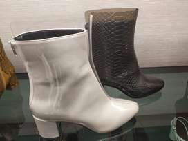 Brand new white boots in size 6. Charles and keith brand.