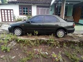 Mazda 323 Familia 1998 Hijau Army