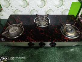 Gas Stove with marble and glass top fitting @2000/-