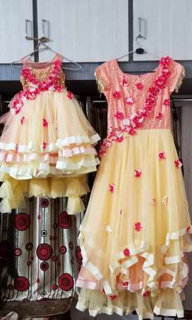 Peach and yellow combination mom and daughter party wear long Frocks