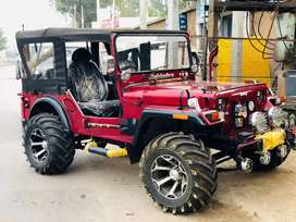 Open willyz jeep in cherry color