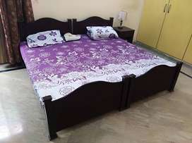 2 single beds with 1 table
