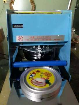 Cup sealing machine with aluminum foil