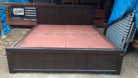 Yrk Brand new. Take wood queen size cot with storage