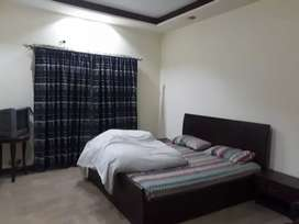 Dha 2 beds daily rent stay with family .Wedding guest book now