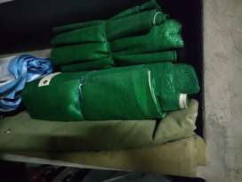 Canvas tarpal and sun protection green plastic sheets.