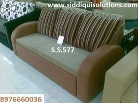 Sofa cum bed 3 seater brown leather off white fabric n strips cushion