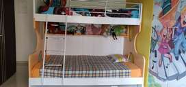 Bunk bed with queen bed in the bottom