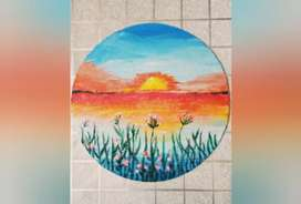 Painting on circle canvas with acrylic paints