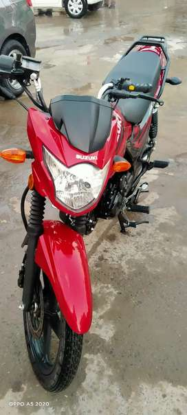 Gr 150 red color Islamabad number life time token 1300 km drive