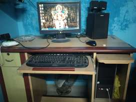 Nice candisan computer with table and spikar