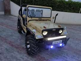 Open and modified jeeps at Singla motor