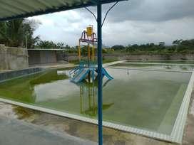 Tanah dan Bangunan dengan fasilitas Kolam