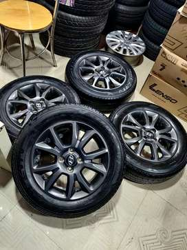 15 inches i20 OEM gun metal grey alloys and MRF 80% tyres set of 4