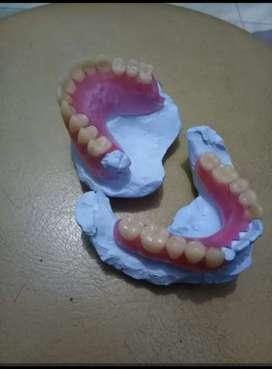 Pemasangan gigi palsu dan veneer