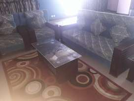 In new condition 5 seater sofa with tables