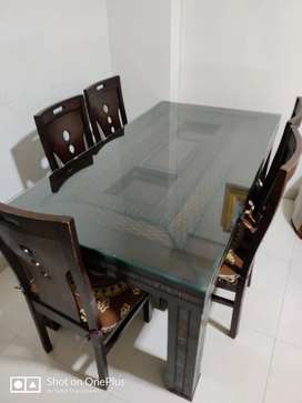 Six seater glass top dinning table