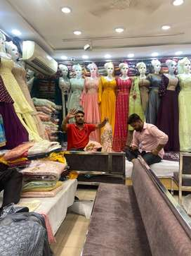 Salesman and backman for ladies suits and readymade dreses