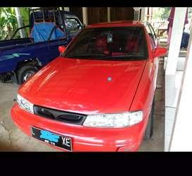 Mobil timor tahun 1997 warna merah