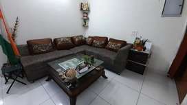 7 seater sofa with wooden glass table