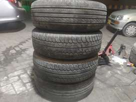 TOTAL 4 TYRES IN GOOD CONDITION 2 ARE OF DUNLOOP 16INCH, 2 of general
