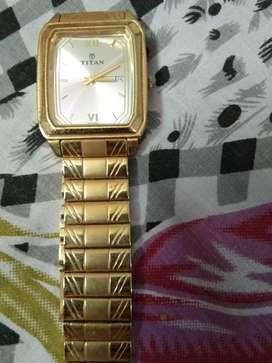 Golden watch TITAN running condition