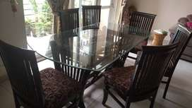 Glass top double shelf dinning table