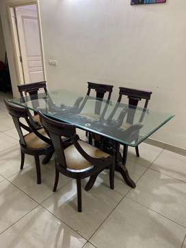 Glass top dinning table with 5 chairs