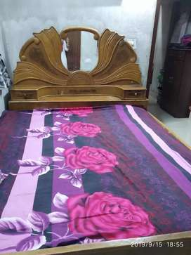 Brown wooden bed and dressing table