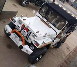 Open white willys jeep