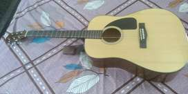 Fender CD 60 V3 acoustic guitar with accessories worth 4500 rupees.