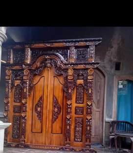 Pintu gebyok ukir kayu Jati melangkah
