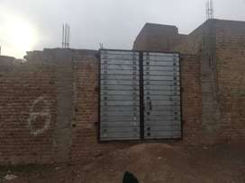8 Marla Plot for Sale  with boundry wall, water bour and door gate.
